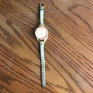 Fossil green & rose gold watch.